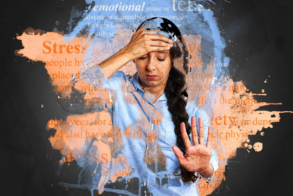 stressed out female surround by words meaning stress, overwhelm, anxiety, etc.